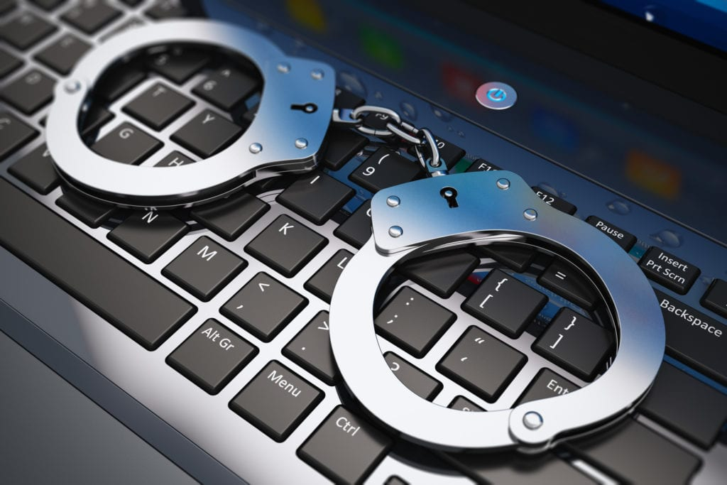 Handcuffs on keyboard