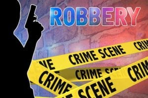 "silhoette of a burglar, with crime scene tape and the word ""Robbery"""