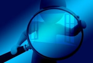 a silhouette of a person looking through a magnifying glass at data