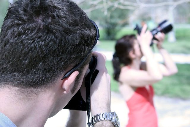 Man taking pictures of woman taking pictures
