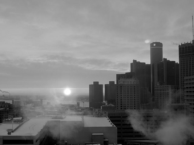 A black and white picture of skyscrapers in Detroit, with the mist of early morning making the picture look ethereal and almost post-apocalyptic.