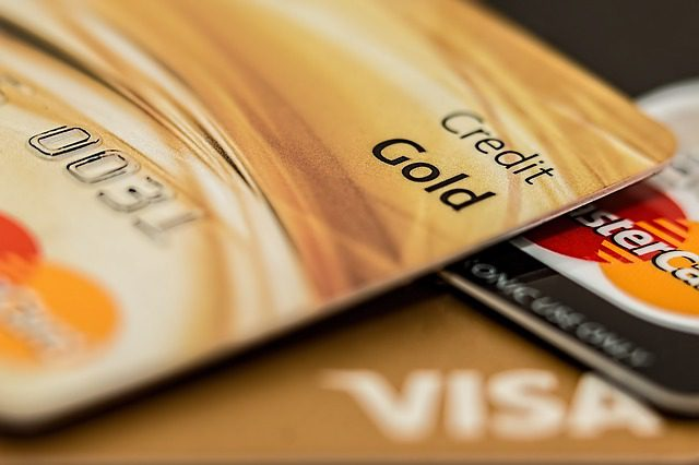 A very close up picture of two credit cards, stacked on top of each other. They are both VISA Mastercards.