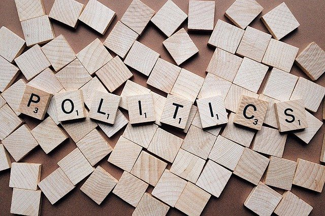 "A selection of scrabble tiles spelling out the word ""politics"""