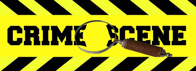 Crime scene tape and a hand held 'spy glass' - both symbols of an ongoing police investigation, where officers collect evidence to be used to determine guilt or innocence.
