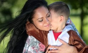 Woman hugging child
