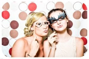Mother and daughter wearing masks at a party
