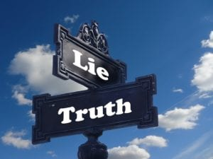 "Signs saying ""Lie"" and ""Truth"""