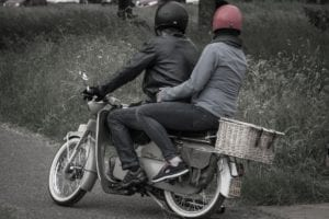 Young couple ridding motorcycle together
