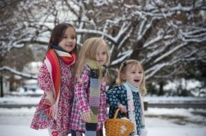 Young girls playing in snow together