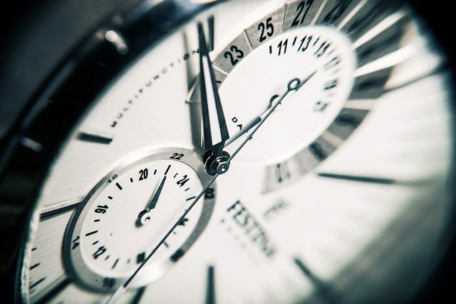 A close up of a watch, with the time ticking away...