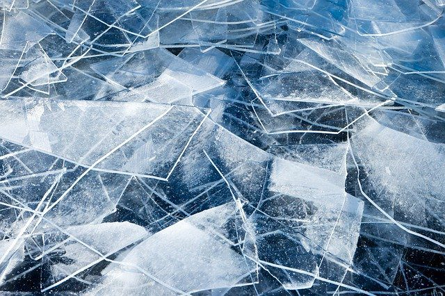 A close up of a broken ice flow, with lots of jagged ice edges.
