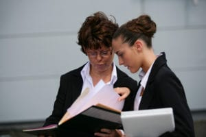 Two CPS workers reviewing papers