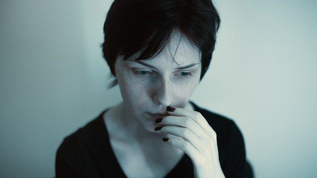 A woman looking worried and afraid