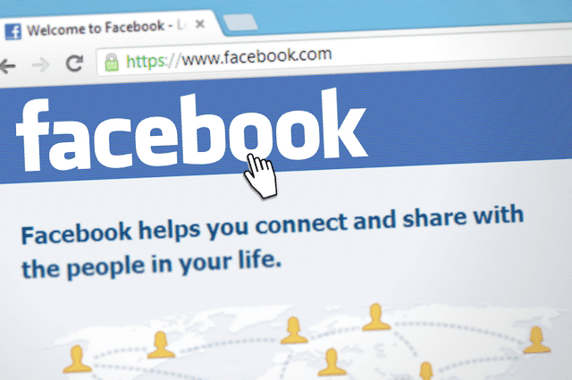 A close up of the Facebook home screen that explains what Facebook is and does, and displays it's iconic logo.