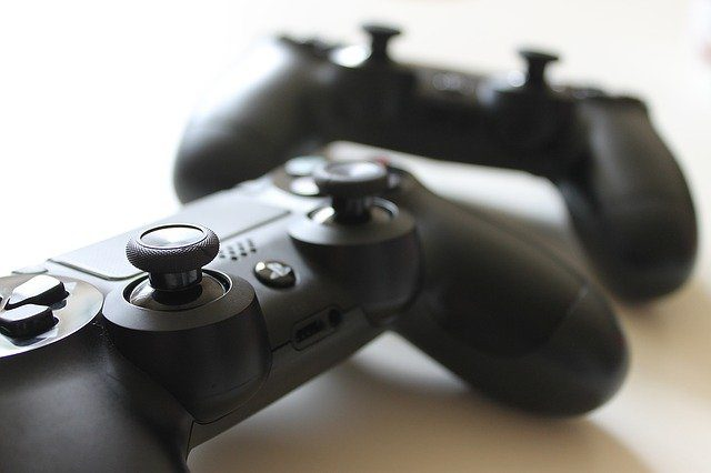 A close up of a game consol, which gives someone complete control over a character or a setting.