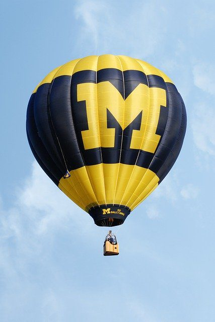 A hot air balloon in U of M's signature corn and blue colors, with the university's large M emblazoned on the side.